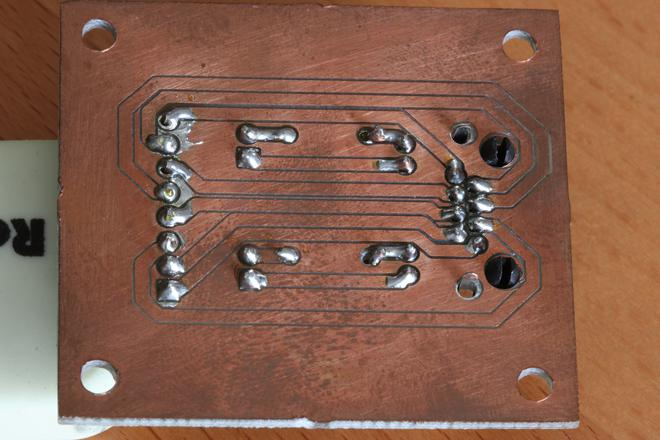 A photo of copper traces of the PCB on the bottom.